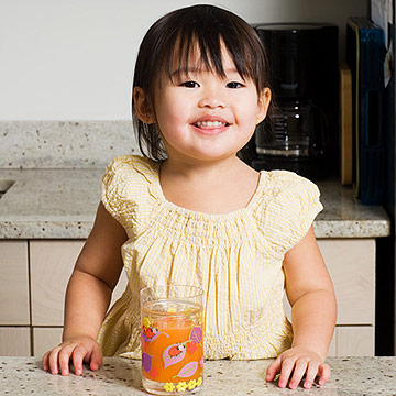 toddler drinking juice