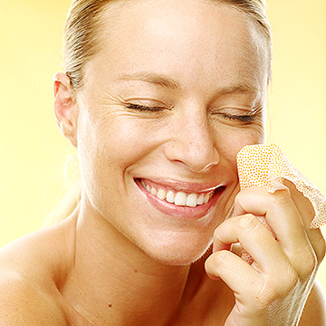 woman cleaning face