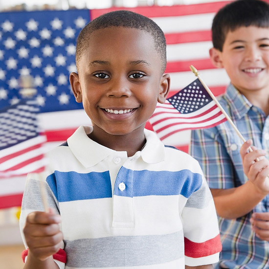 Boys holding American flags-1305661737991.xml