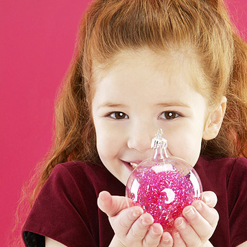 child holding ornament