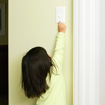 Child turning off light switch