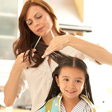mother cutting child's hair