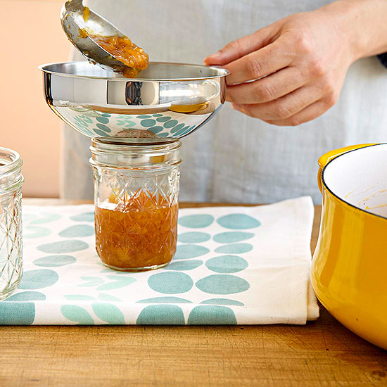 filling jars with funnel