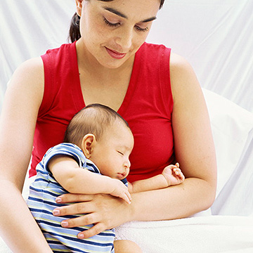 mother holding new baby