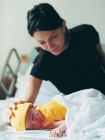 mother looking at newborn baby