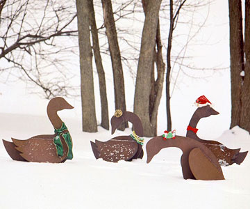 Garden geese with holiday decorations