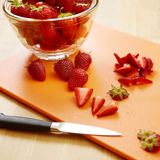 cutting strawberries