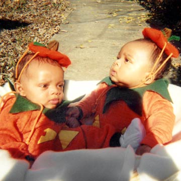 Twins In Pumpkin Costumes