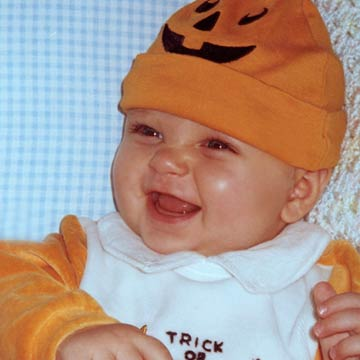 Baby With Pumpkin Cap