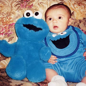 Marcus In Cookie Monster Bib With Cookie Monster Plush