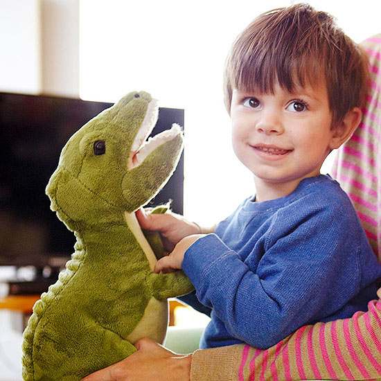 boy holding stuffed animal