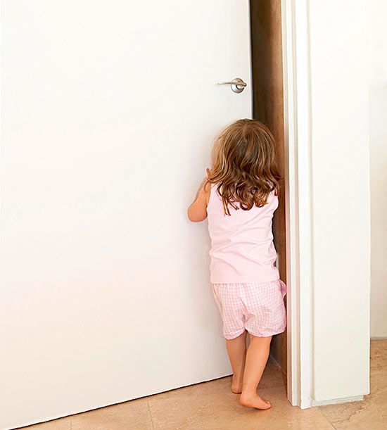 girl pushing open a door