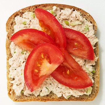 Tuna salad and sliced tomato sandwich