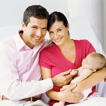 couple holding new baby