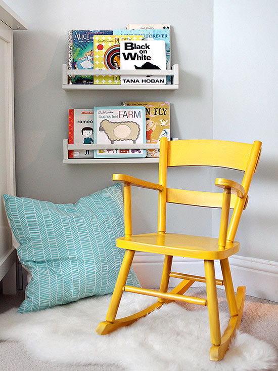 Yellow rocking chair and books