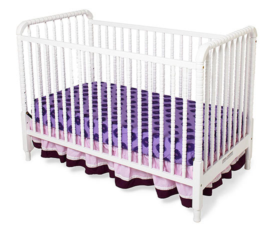 Purple and pink bedding on crib