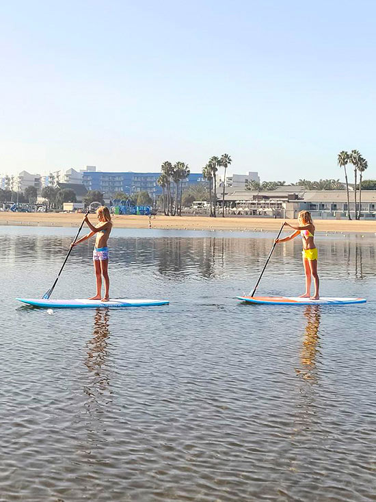 Mother's Beach stand-up paddlers