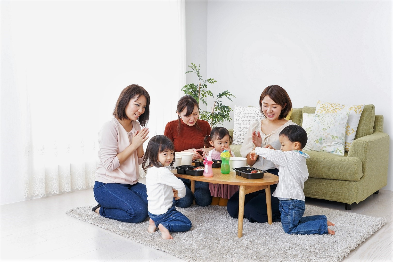 Asian Mom and Baby Friends Eating