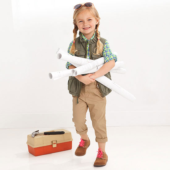 Girl holding scrolls next to toolbox