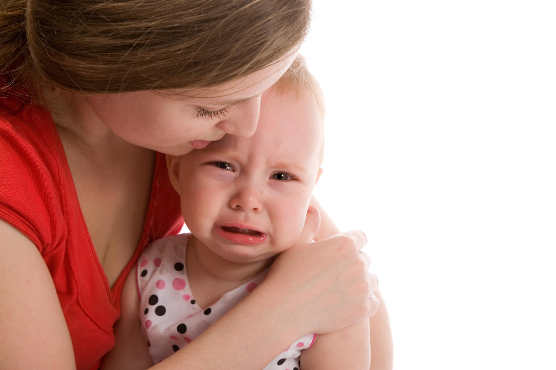 Mom soothing crying baby