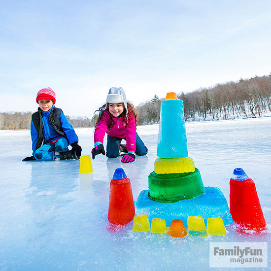 Colorful ice blocks with two kids behind them