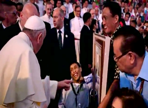 Pope Francis meets a man with cerebral palsy
