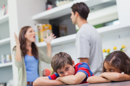 Couple arguing in front of kids, boy and girl