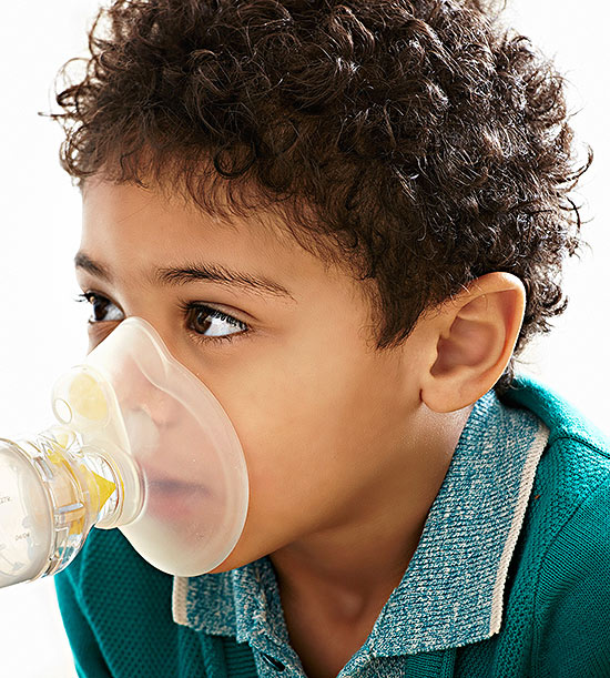 Child using inhaler mask