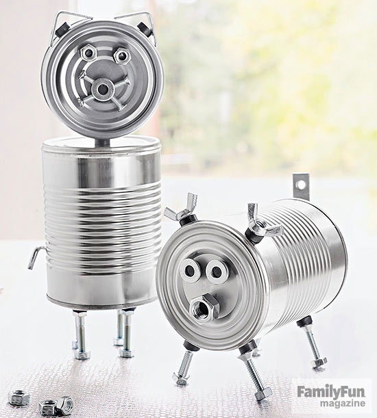 Two silver cans animals, decorated with nuts and bolts
