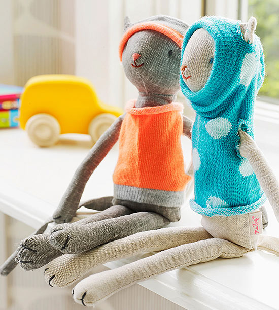 Stuffed animals in sock clothes