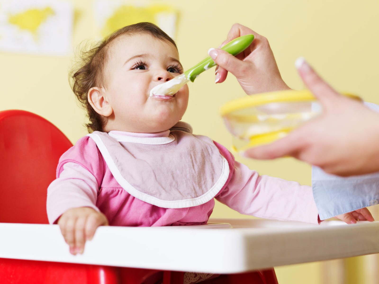 baby eating from spoon