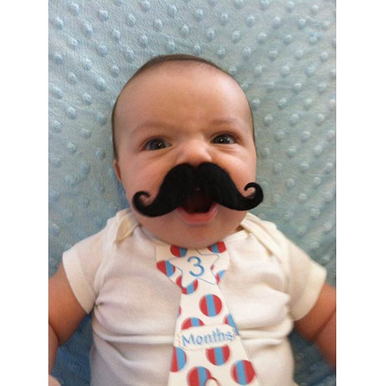 Donning a faux mustache makes people take your demands seriously. Even at the wee age of 3 months.