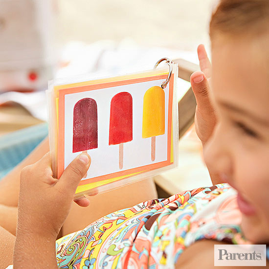 child playing with beach flashcards