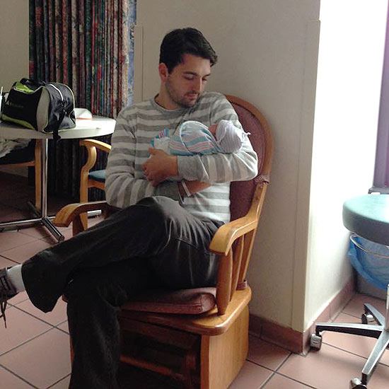 father holding preemie baby