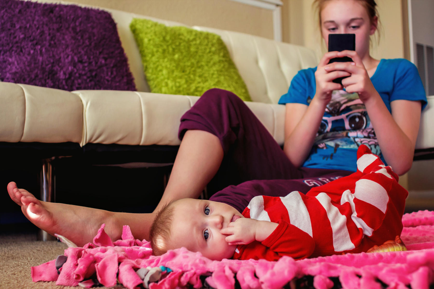 Preoccupied Babysitter Looking at Phone