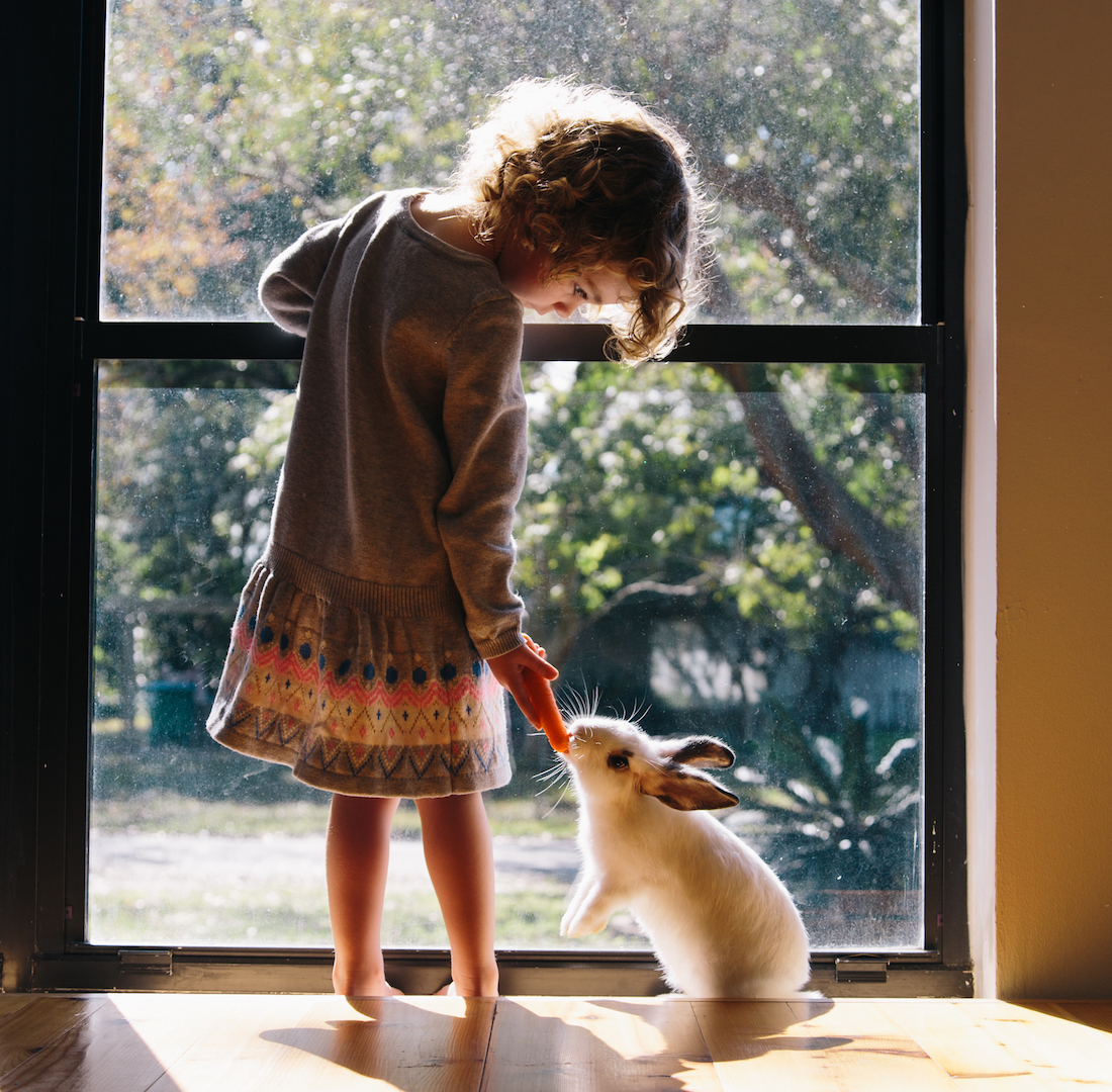 Girl with Pet Bunny Rabbit