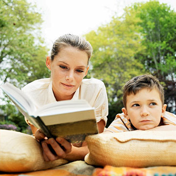 mom reading book to son