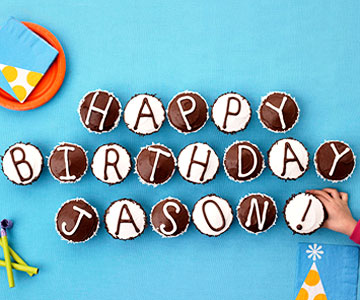 Cupcakes that spell out a happy birthday message