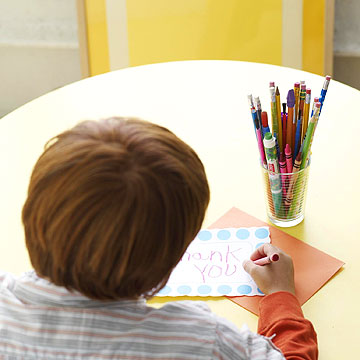 boy writing thank you card