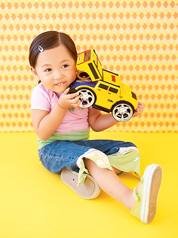 Girl Holding Toy Truck