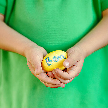 boy holding decorated Easter egg