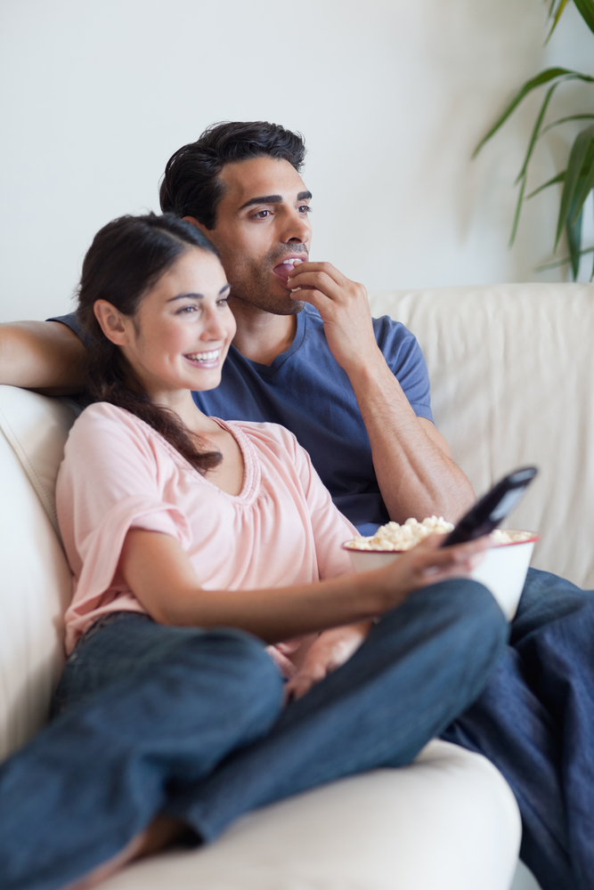 Quizler Obsessed Middle Ground Result Couple On Couch Watches TV Eating Popcorn
