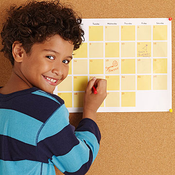 boy writing on calendar