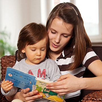babysitter reading to toddler