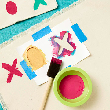Placemat craft with paint and paintbrush