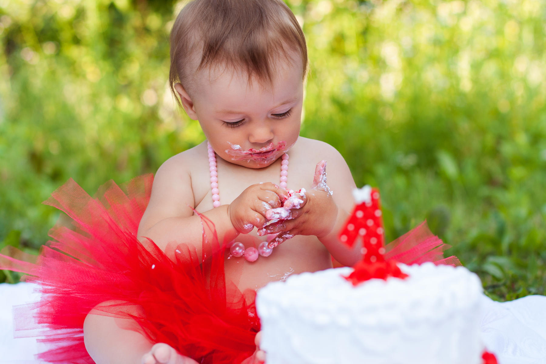 Toddler in Red Tutu Eating Cake