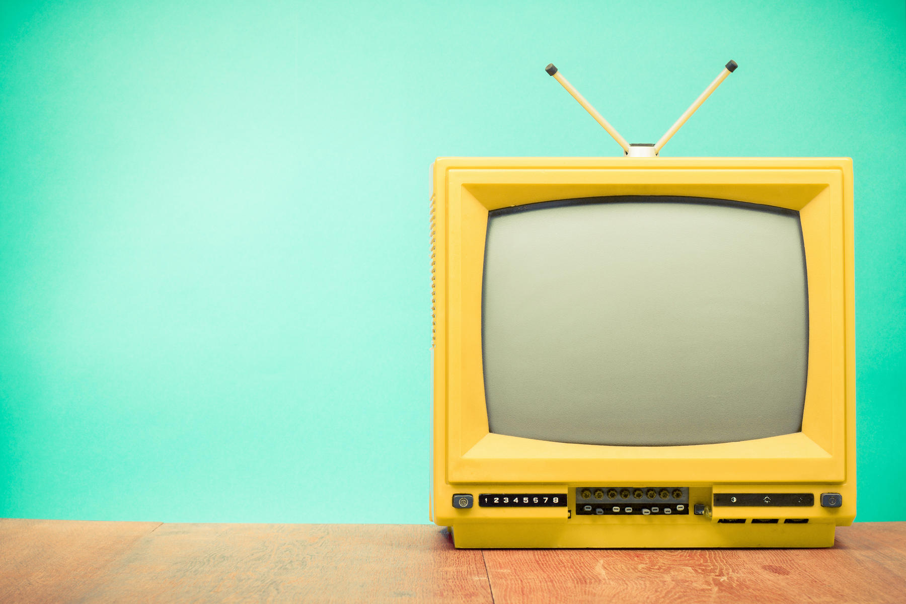 Yellow Vintage Television with Blue Background