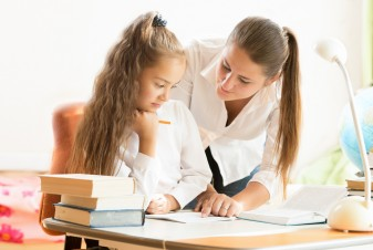 mom helping daughter do homework