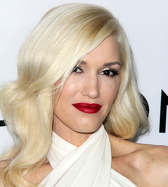 Gwen Stefani smiling in white dress