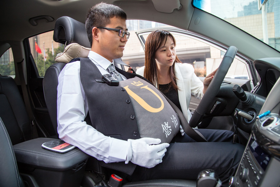 ubo driver in car with fake pregnant belly